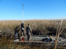Audubon team members conduct a channel survey at Farm Creek Marsh in Maryland. Photo: David Curson